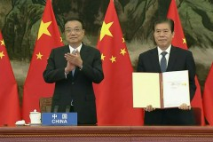 World's largest free trade agreement signed at end of ASEAN Summit in coup for China