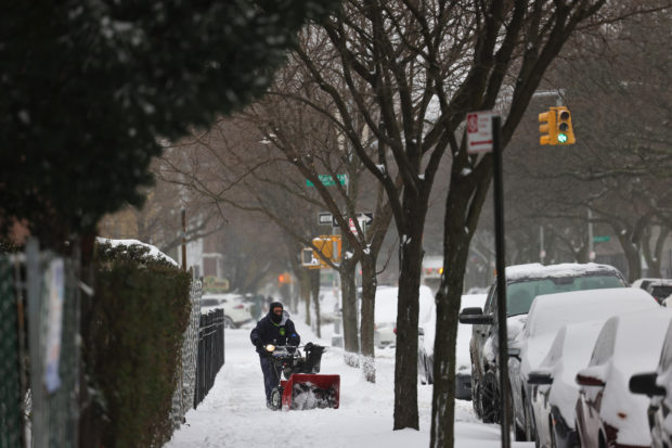 Snow brings joy, and misery, to pandemic-weary New York