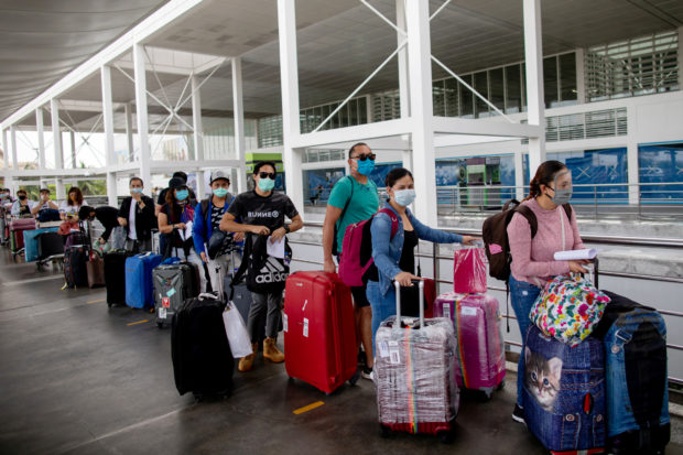 OFWs exempted from travel ban on new COVID-19 strain-hit countries