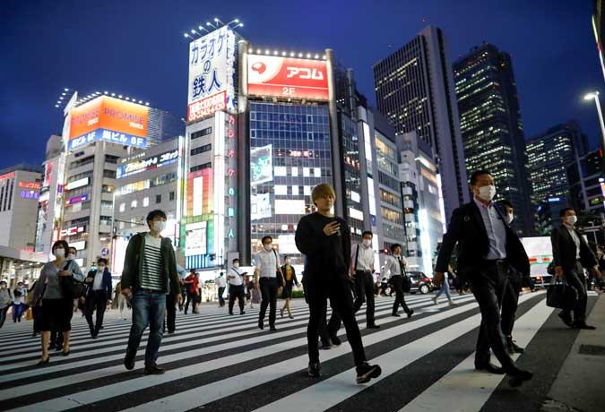 Tokyo raises COVID-19 alert level to highest